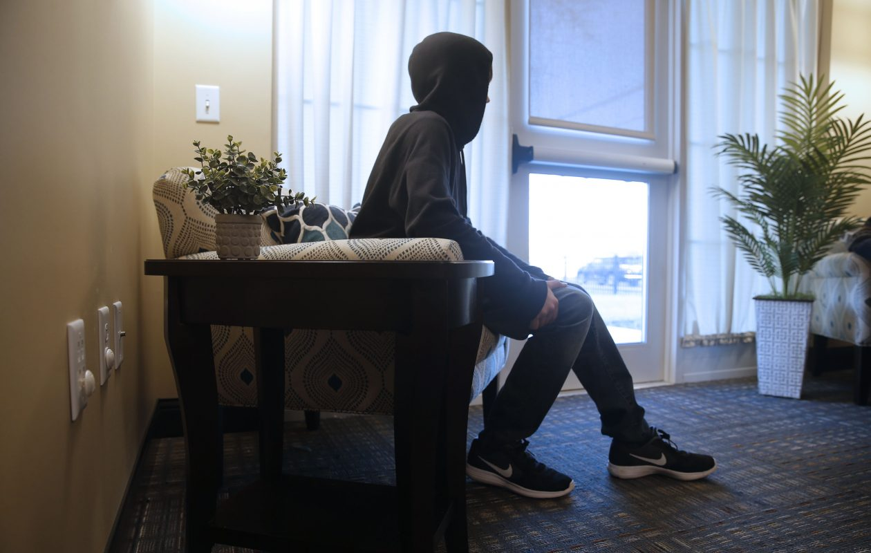 A teenager in emergency foster care tells his story at Baker Victory Services, Lackawanna. (Robert Kirkham/The Buffalo News)