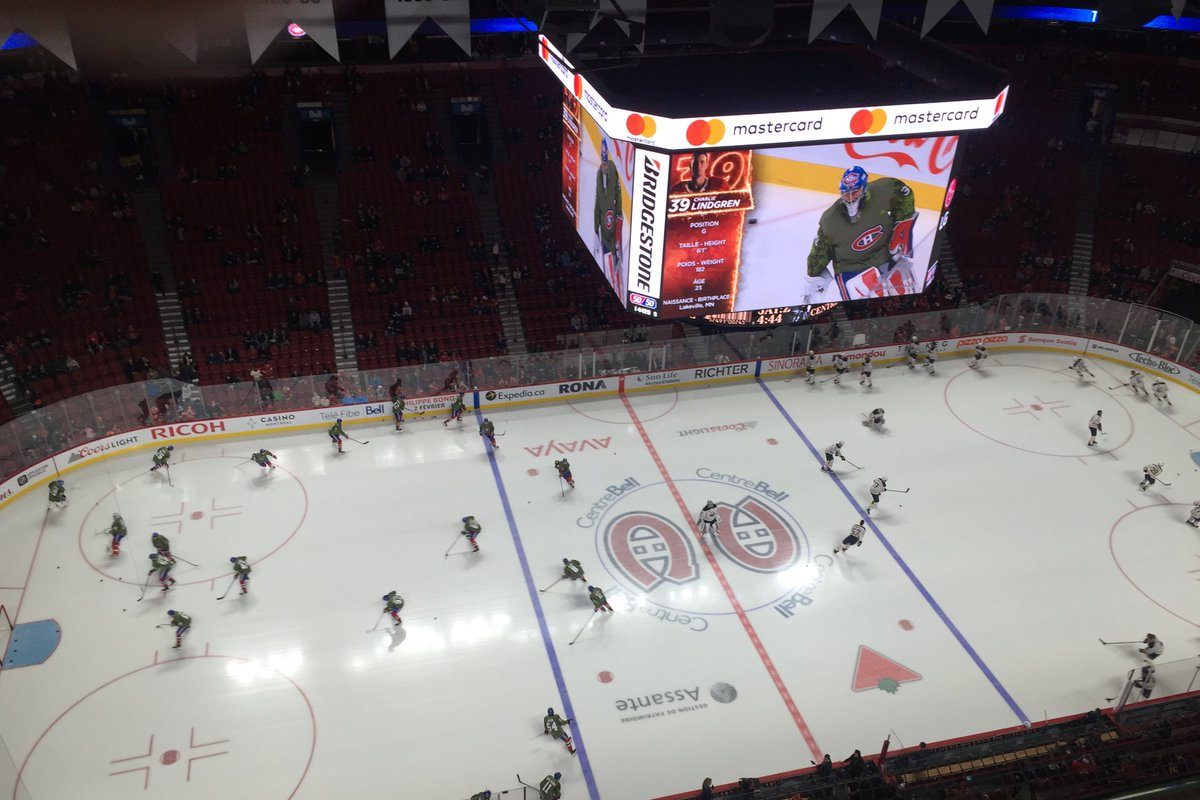 The Sabres and Canadiens, who were wearing green Remembrance Day sweaters, warm up in Bell Centre (Mike Harrington/Buffalo News).