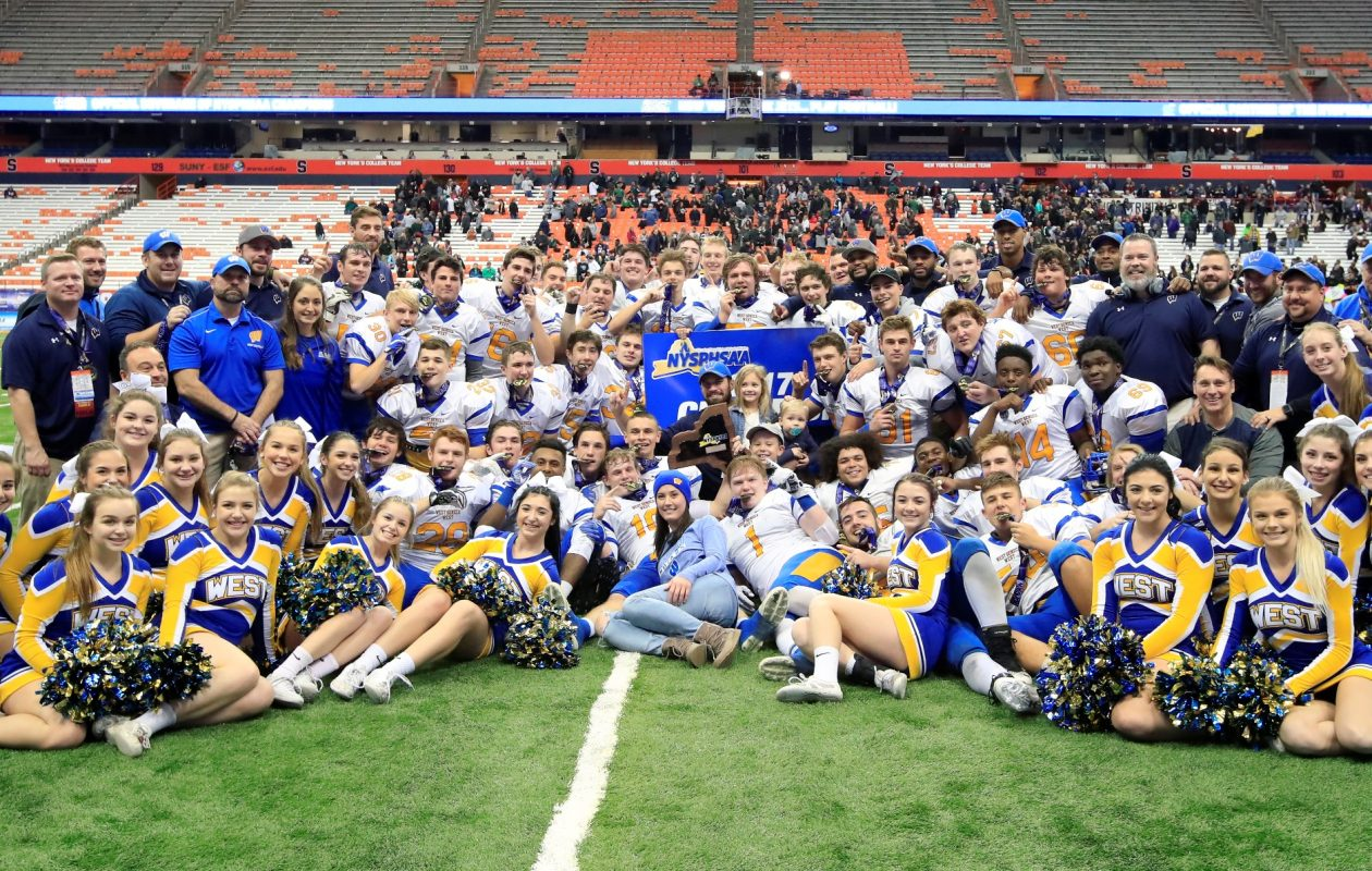 West Seneca West players, coaches and cheerleaders celebrate after defeating Yorktown for the Class A New York State Championship game at the Carrier Dome on Friday, Nov. 24, 2017. (Harry Scull Jr./ Buffalo News)