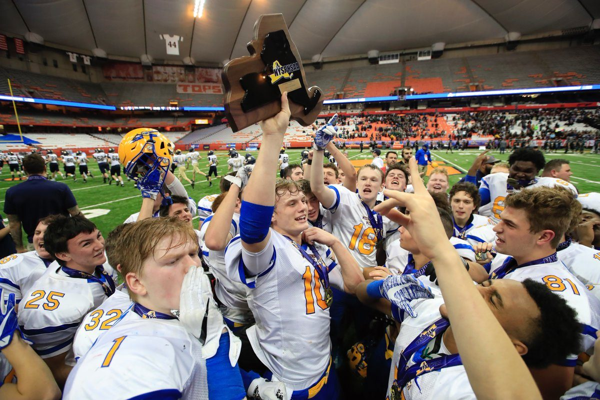 Matt Myers and the West Seneca West football team celebrate at the Carrier Dome in Syracuse after securing the program's first state championship with a 14-6 triumph over I-Yorktown. (Harry Scull Jr./Buffalo News)