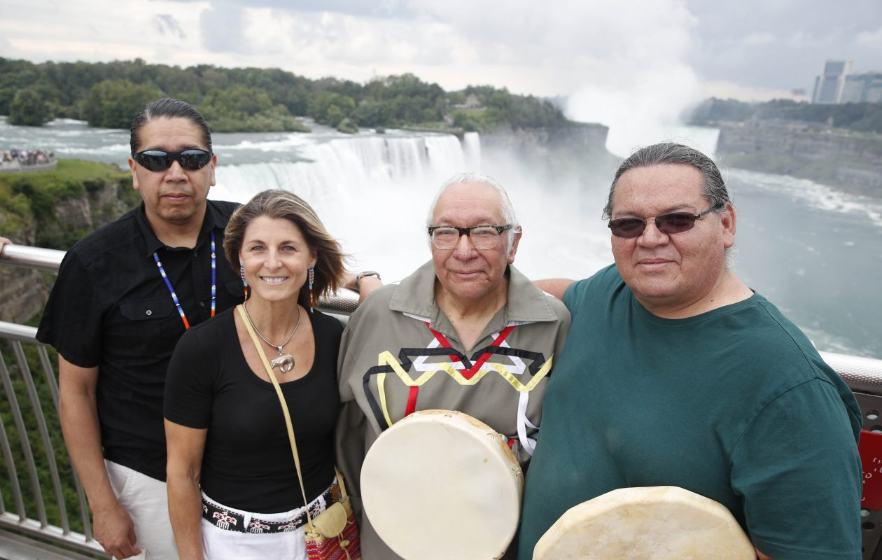 Drums were used to call and reply across the Niagara gorge at the Prospect Point Observation Tower as part of a live concert inspired by the documentary 'Rumble: The Indians Who Rocked the World.' From left are Gary Parker (Seneca), Michele-Elise Burnett (Metis), Allan Jamieson (Cayuga), and Philip Davis (Mohawk). Burnett had the idea for the drum communication across the gorge before the free live concert in Oakes Garden Theatre on the Canadian side. (Sharon Cantillon/Buffalo News file photo)