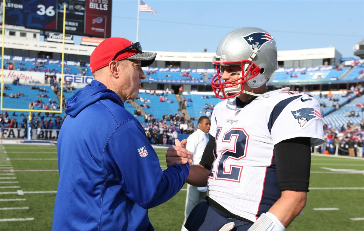 Jim Kelly meets with longtime friend Tom Brady prior to Sunday's game. (James P. McCoy/Buffalo News)