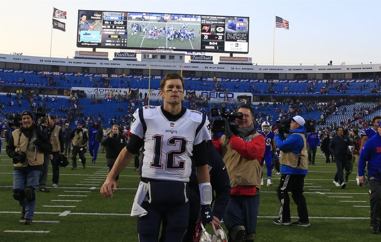 Tom Brady makes his way off the field following the Patriots' win over the Bills. (Harry Scull Jr./Buffalo News)