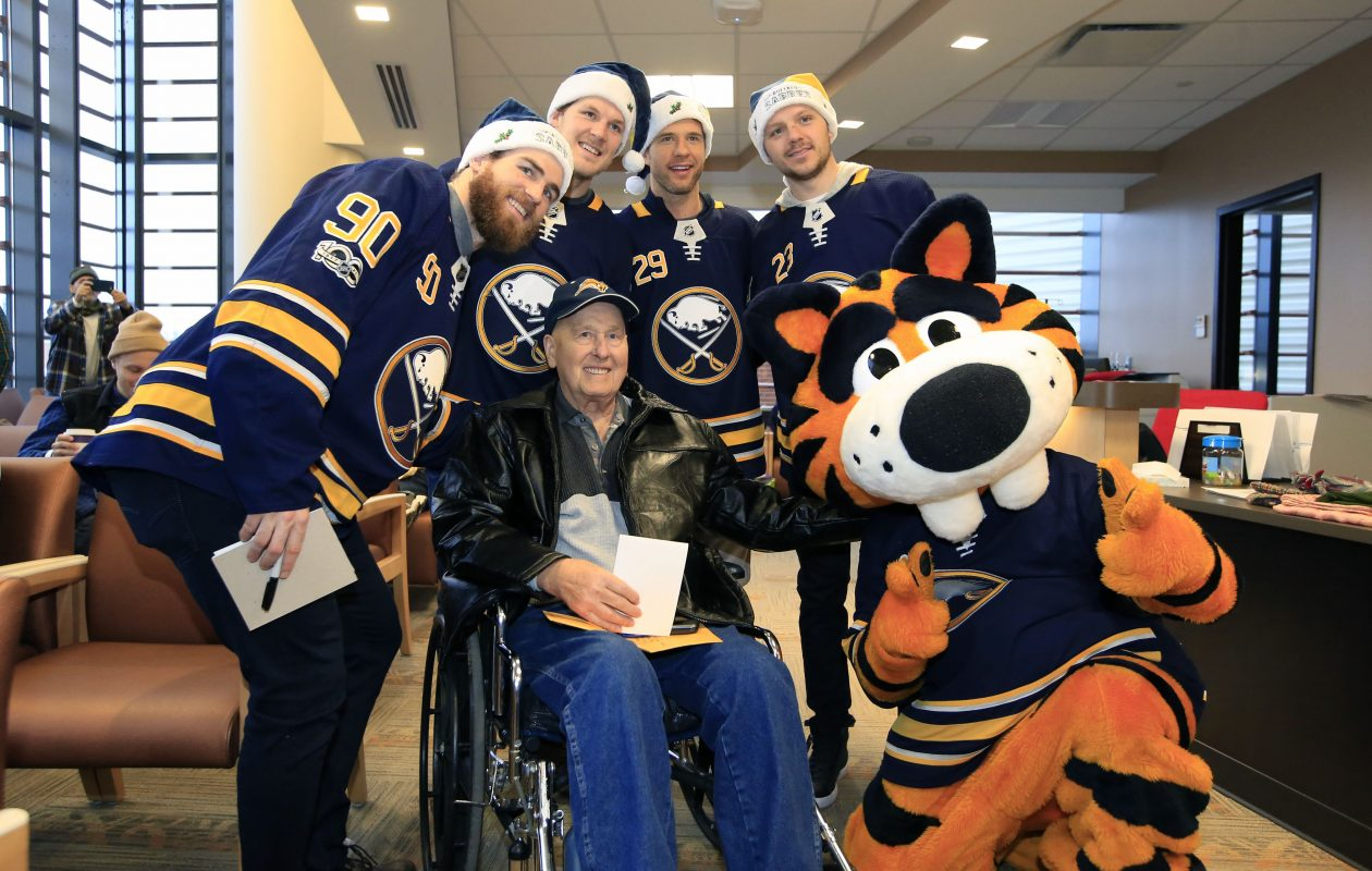 The Buffalo Sabres' Ryan O'Reilly, Jake McCabe, Jason Pominville and Sam Reinhart visit with Bob Closs during a holiday visit to Roswell Park Cancer Institute. (Harry Scull Jr./Buffalo News)