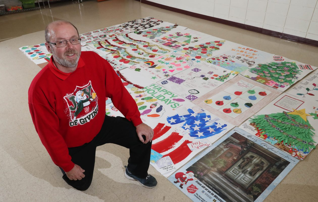 Chris Gresart, head of social ministries at Salvation Army in Lockport, sends giant Christmas cards to soldiers abroad and locally. (Sharon Cantillon/Buffalo News)