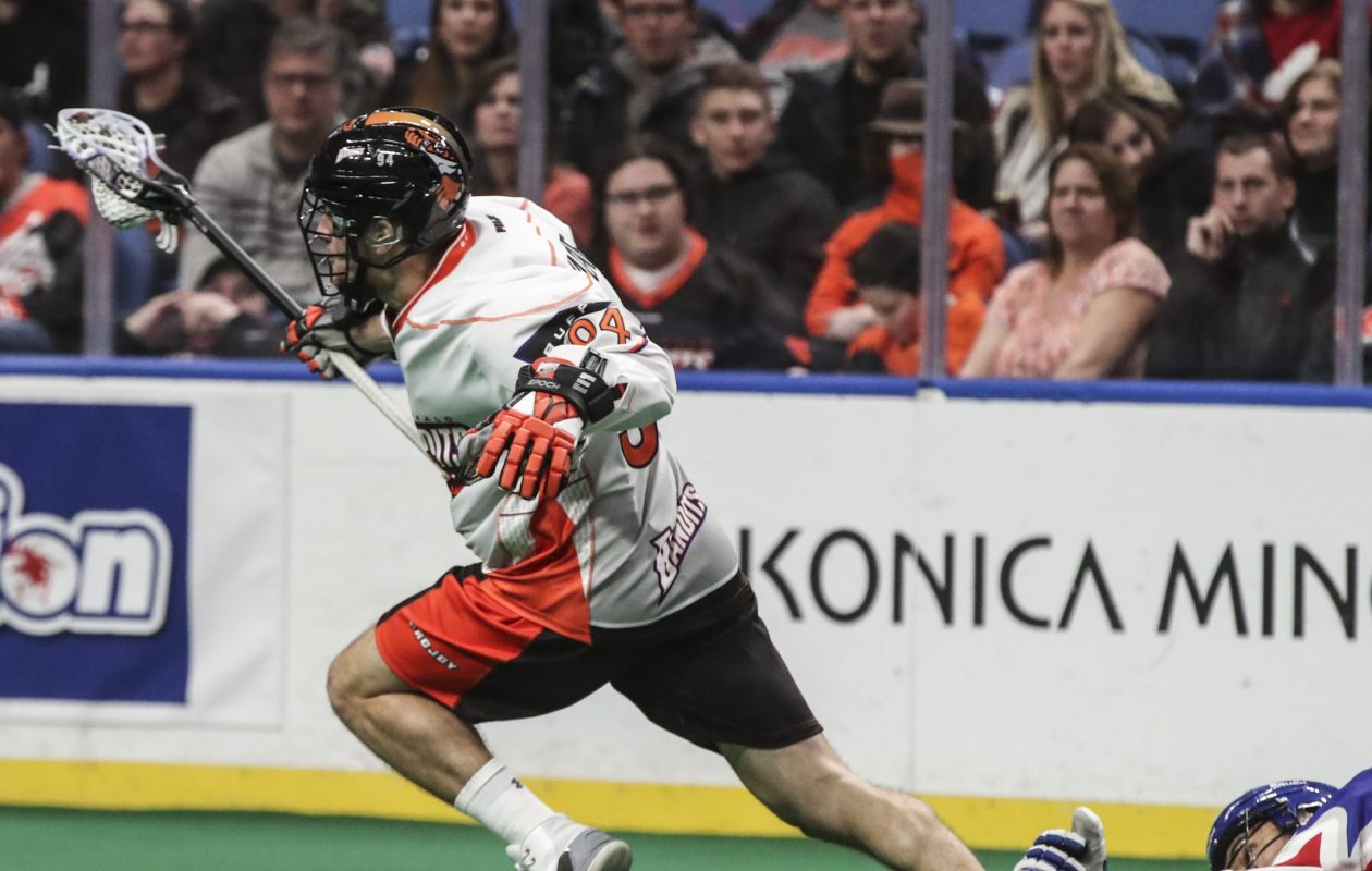 Buffalo Bandits Ryan Wagner gets tripped by Toronto Rock's Damon Edwards in the second period of the home opener at Key Bank Center in Buffalo,N.Y. on Friday, Dec. 8, 2017.  (James P. McCoy / Buffalo News)