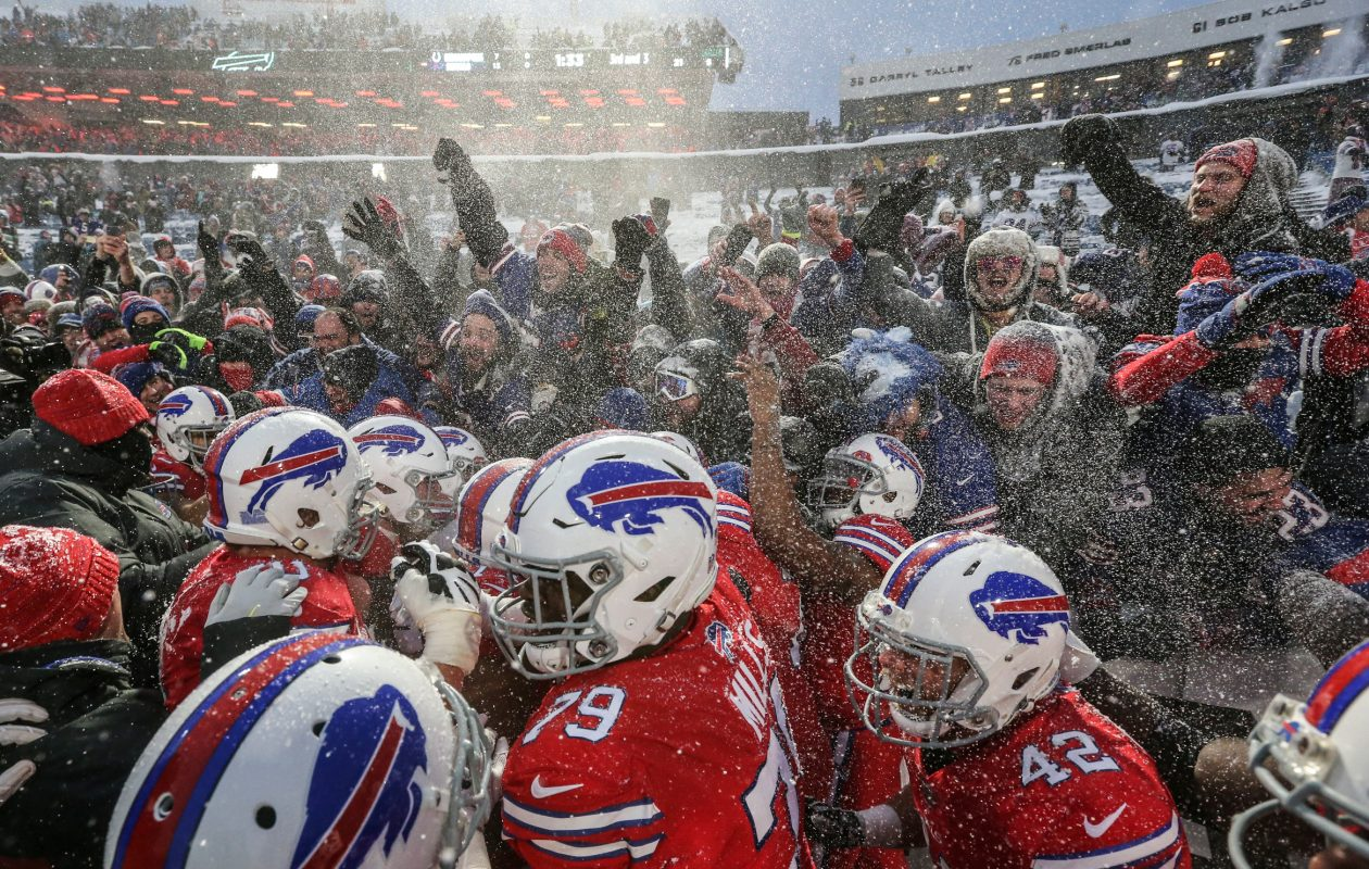 Buffalo Bills running back LeSean McCoy (25) celebrates with teammates and fans after scoring a 21-yard touchdown in overtime to beat the Indianapolis Colts. (James P. McCoy/Buffalo News)