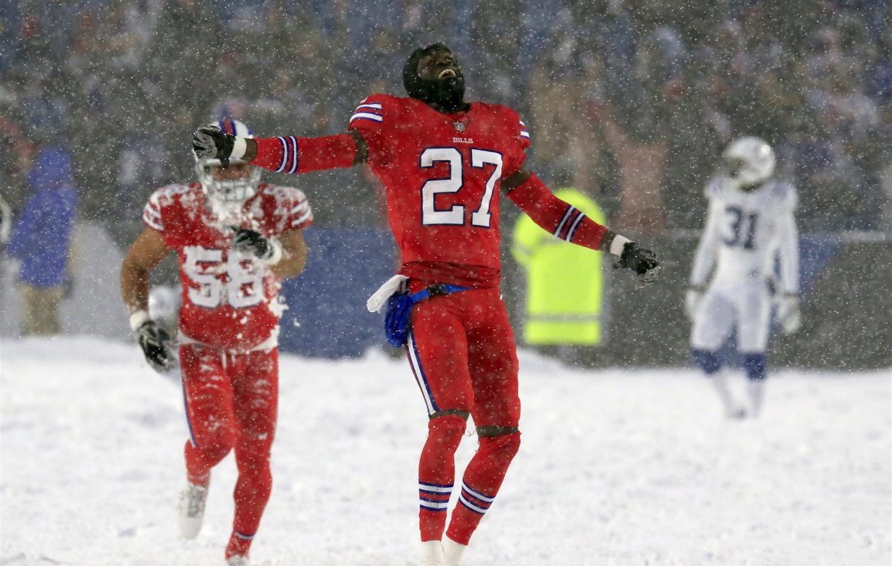Tre'Davious White celebrates during the Bills' 13-7 win over the Colts on a snowy New Era Field (Harry Scull Jr./Buffalo News)