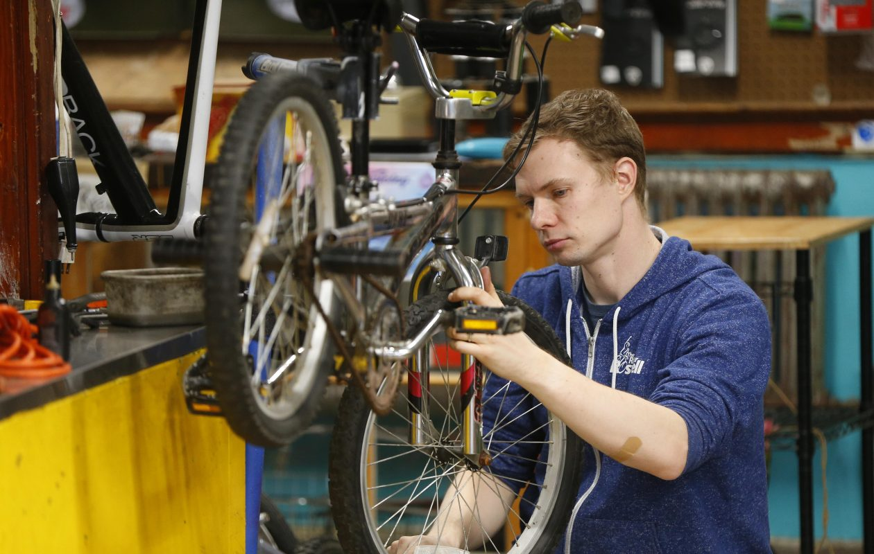 Kevin Purdy repairs a bike for the holidays at the Community Bike Workshop in Buffalo Sunday. (Mark Mulville/Buffalo News)