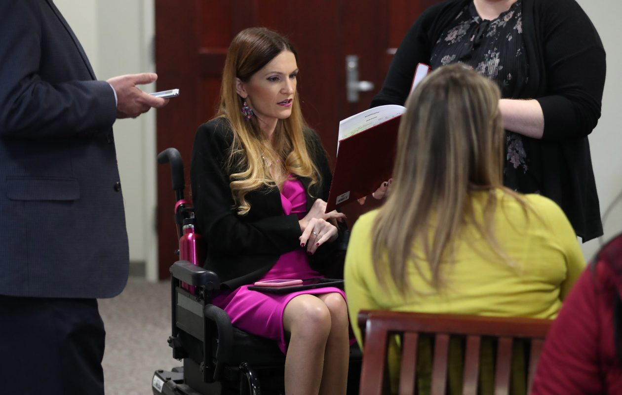 Shannon Filbert became a quadriplegic  as a result of a car accident when she was 16.  She's now a confidential law clerk for Family Court Judge Lisa Bloch Rodwin and is the only person with disabilities working as a law clerk in the district. She works on a family adoption case, Tuesday, Dec. 19, 2017. (Sharon Cantillon/Buffalo News)