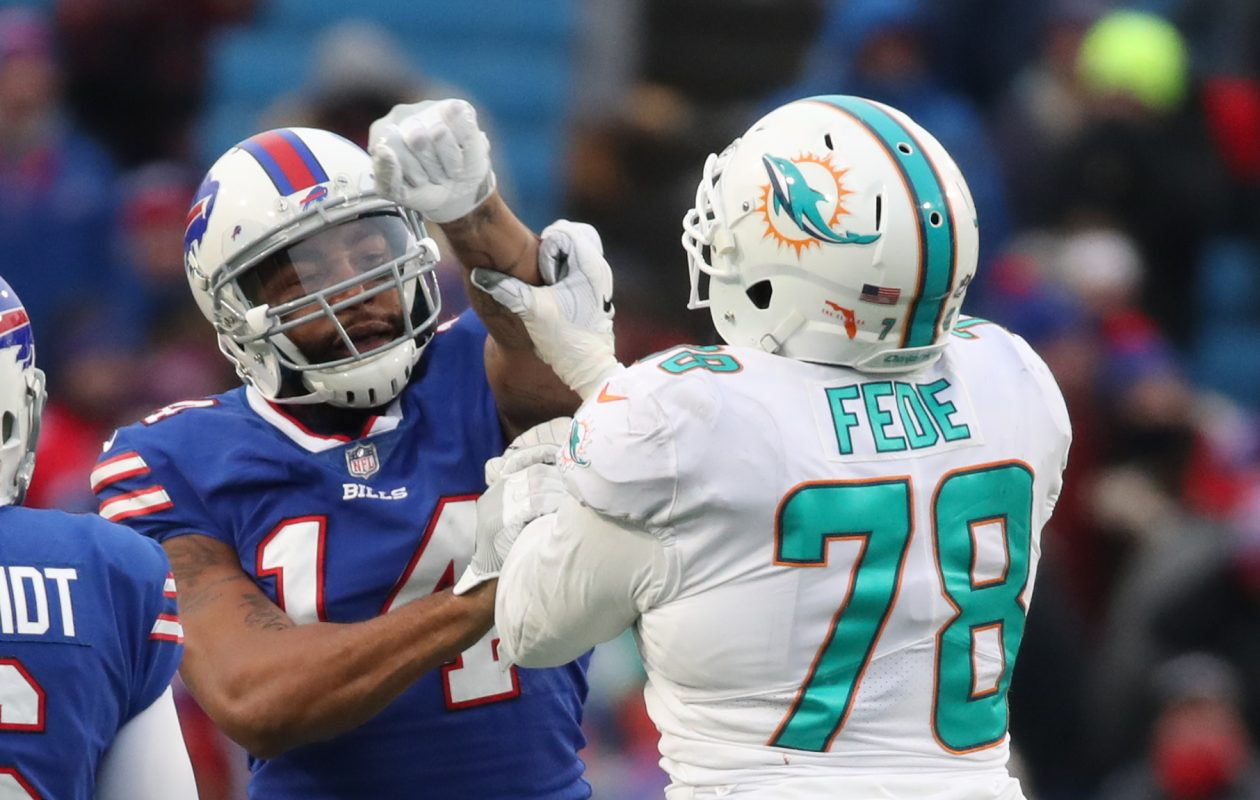 Buffalo Bills quarterback Joe Webb (14) and Miami Dolphins defensive end Terrence Fede (78) mix it up in the fourth quarter at New Era Field on Sunday, Dec. 17, 2017. (James P. McCoy/Buffalo News)