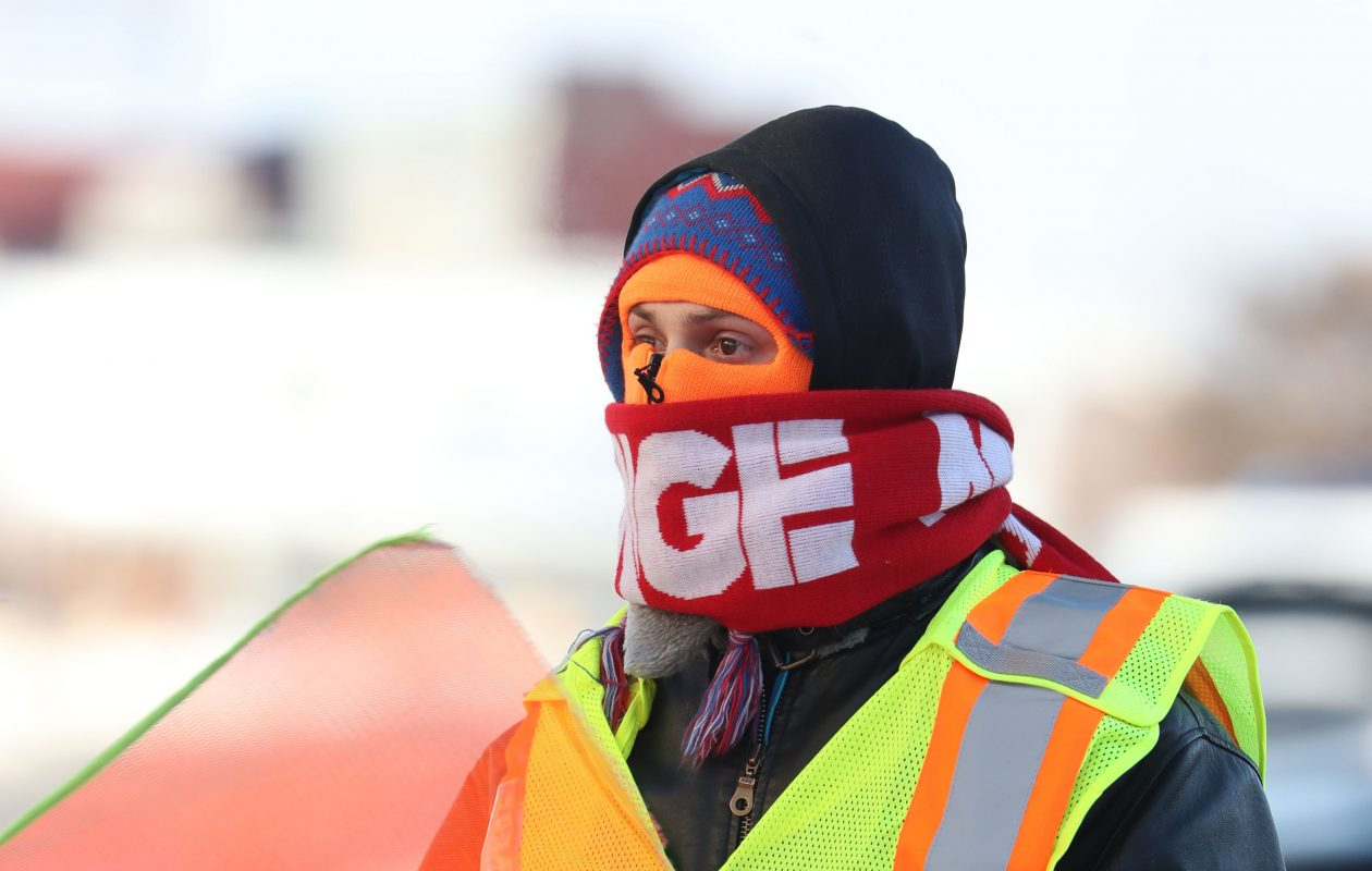 Teen and single digit temperatures will continue all week.  Daniel Wright, parking attendant for Pay2Park, is well dressed as he parks those who have come to watch World Juniors hockey in downtown Buffalo, Wednesday, Dec. 27, 2017. (Sharon Cantillon/Buffalo News)