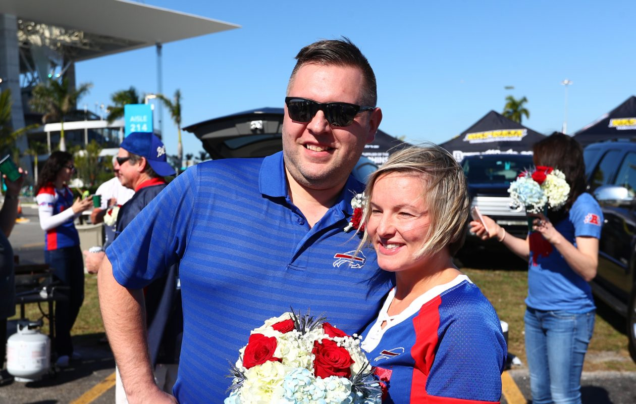 Matthew Lee and Rachel Phillips, of Hamburg, surprised their friends by getting married in the parking lot before the Buffalo Bills/Miami Dolphins game at Hard Rock Stadium in Miami on Sunday, Dec. 31, 2017.  (James P. McCoy/Buffalo News)