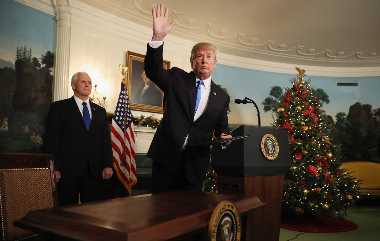 President Trump waves to reporters, as Vice President Pence  looks on, after announcing that the U.S. government will formally recognize Jerusalem as the capital of Israel in the Diplomatic Reception Room at the White House December 6, 2017 in Washington, DC. (Getty Images)