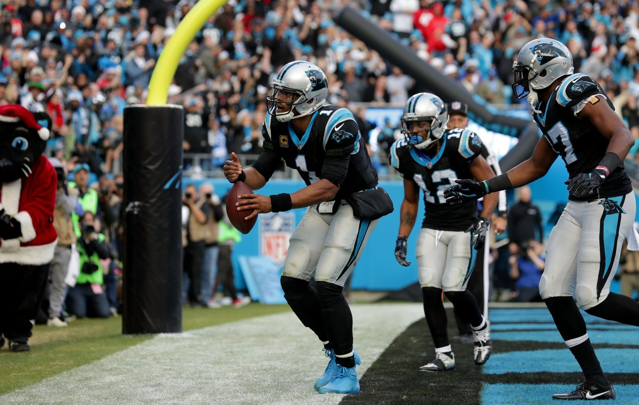 Cam Newton celebrates his game-winning touchdown against Tampa Bay by lighting an imaginary birthday candle on the ball for his son. (Streeter Lecka/Getty Images)