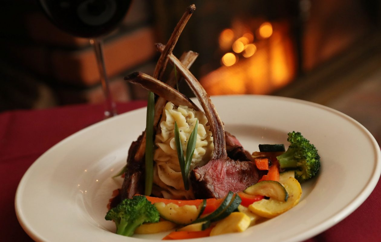 Asa Ransom Houses Frenched half rack of lamb is pan-seared and served with a vanilla bourbon glaze. (Sharon Cantillon/Buffalo News)