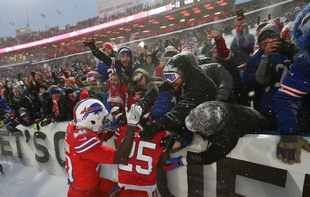 Buffalo Bills running back LeSean McCoy celebrates with his teammates and the fans after scoring a 21-yard touchdown in overtime to beat the Indianapolis Colts 13-7 at New Era Field in Orchard Park on Sunday, Dec. 10, 2017.  (James P. McCoy/Buffalo News)