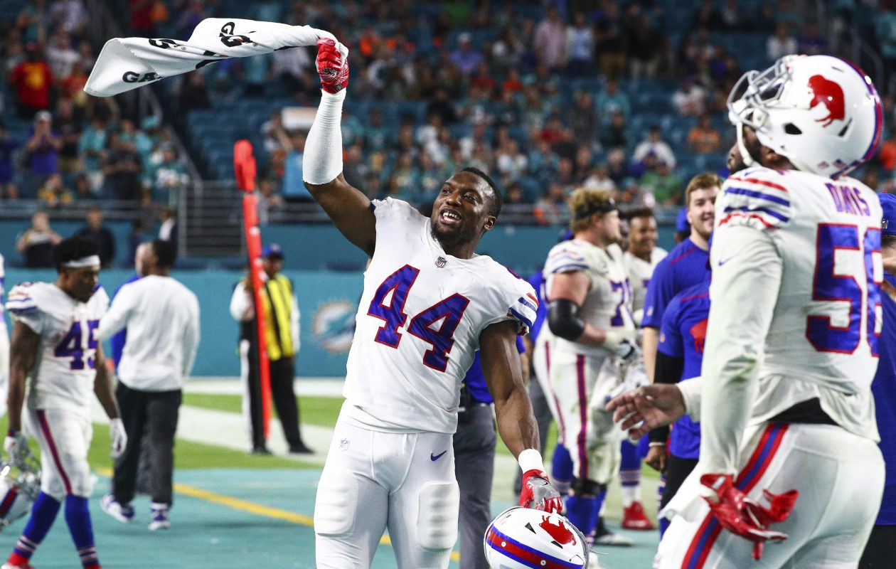 Buffalo Bills linebacker Deon Lacey (44) celebrates on the sidelines after the Bills secure the win in the fourth quarter at Hard Rock Stadium in Miami Gardens, Florida on Sunday, Dec. 31, 2017.  (James P. McCoy / Buffalo News)