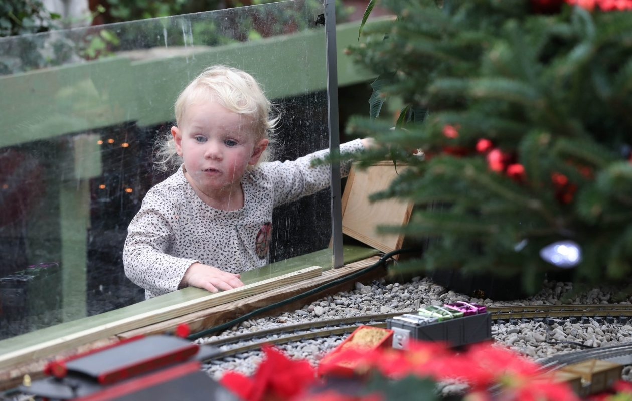 Charlotte Markel, 2, who came with her grandmother, already knows how to operate the train. She's looking for the small Thomas the Train engine. (Sharon Cantillon/Buffalo News)