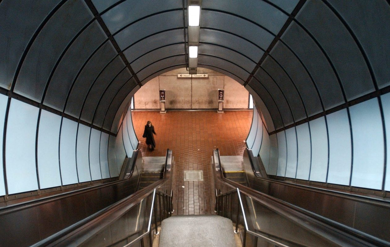 A lone passenger approaches the escalator in the Metro Rail station at Main and Delavan in Buffalo.  (Derek Gee/Buffalo News)