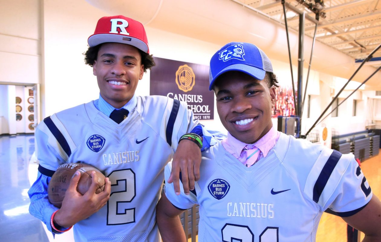 Canisius football players Paul Woods (Rutgers), left,  and Kenyatta Huston (Central Connecticut) are among local players taking advantage of the early signing period (Harry Scull Jr./ Buffalo News)