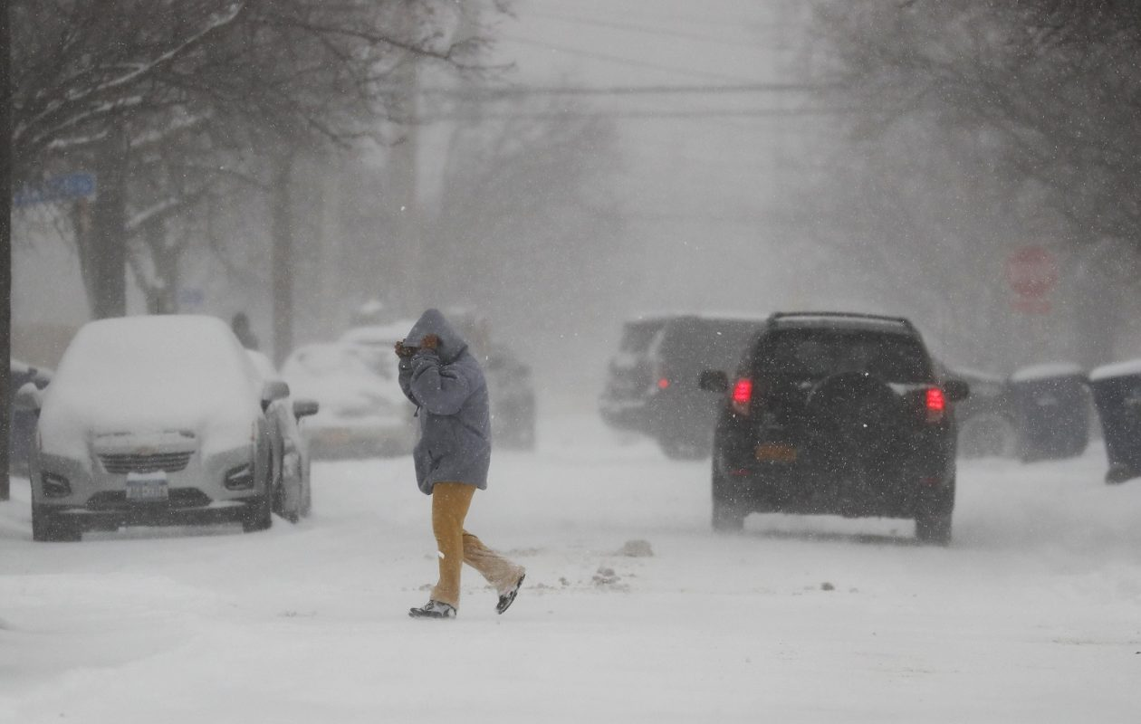 People brave the blowing snow Friday on Hamilton Street. (Mark Mulville/Buffalo News)
