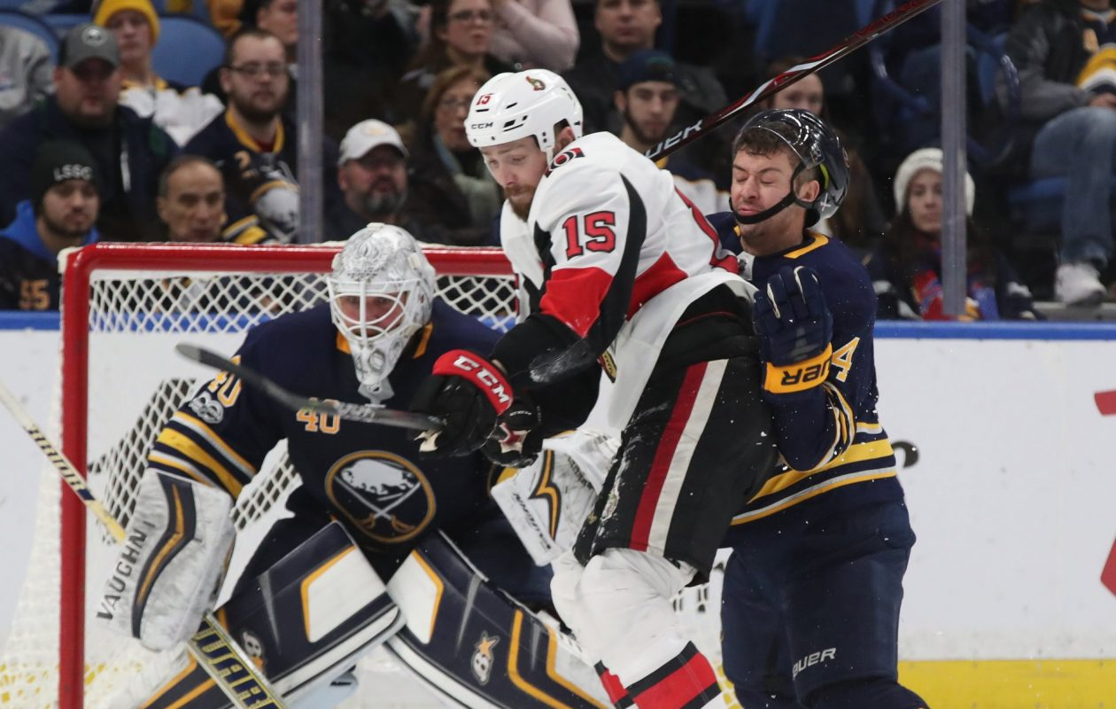 Sabres goaltender Robin Lehner gets a clear view of the puck as teammate Josh Gorges battles Ottawa's Zack Smith on Tuesday. (James P. McCoy/Buffalo News)