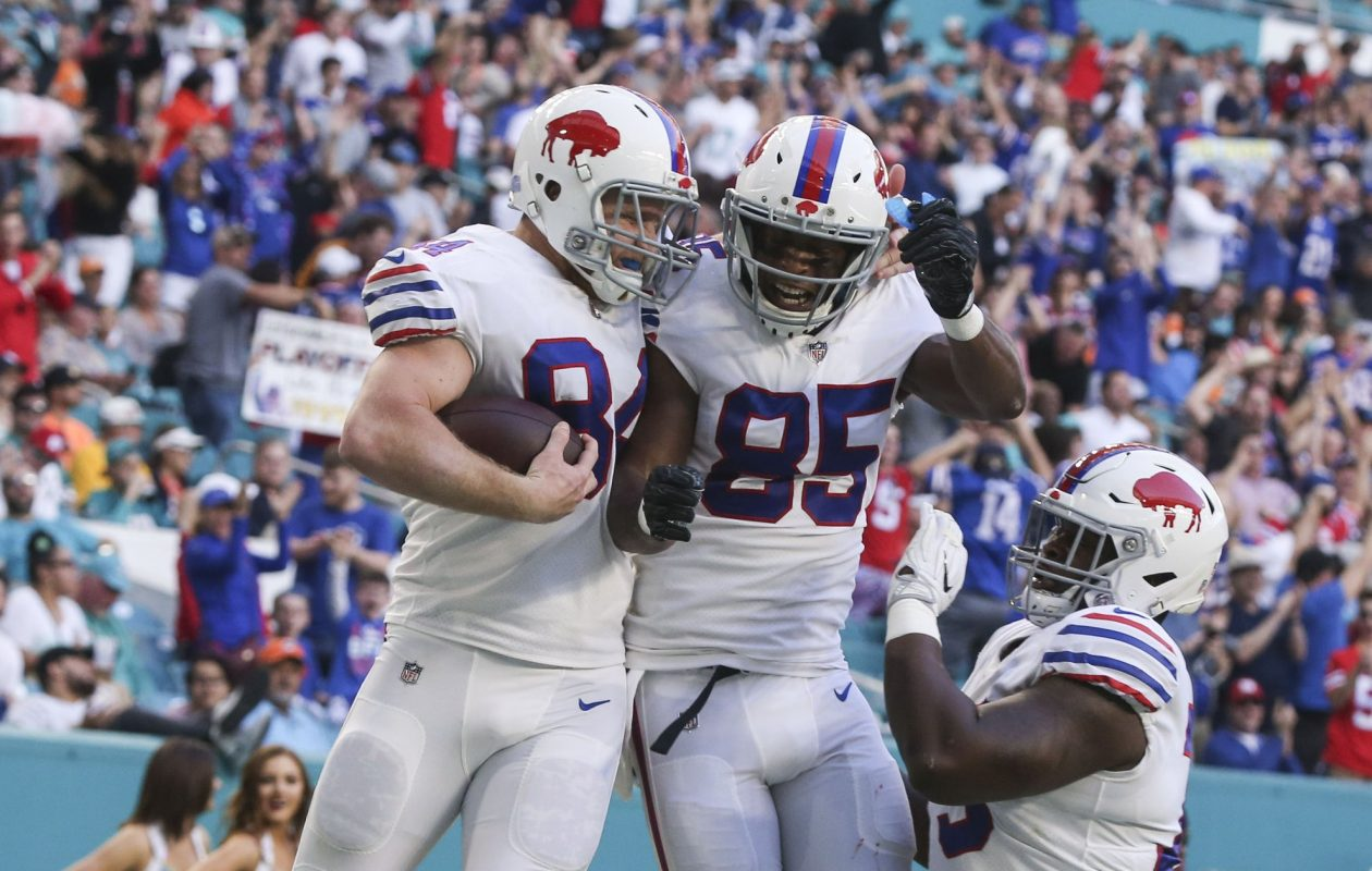 Buffalo Bills tight end Nick O'Leary (84) and Buffalo Bills tight end Charles Clay (85) celebrate after a touchdown against the Miami Dolphins in the first quarter at Hard Rock Stadium in Miami Gardens, Florida on Sunday, Dec. 31, 2017.  (James P. McCoy / Buffalo News)