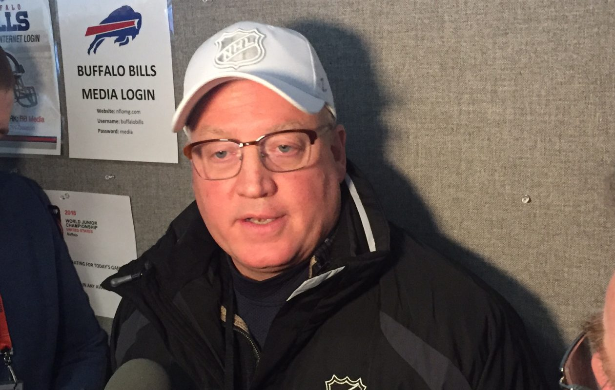 Bill Daly meets reporters Friday in New Era Field (Mike Harrington/Buffalo News).