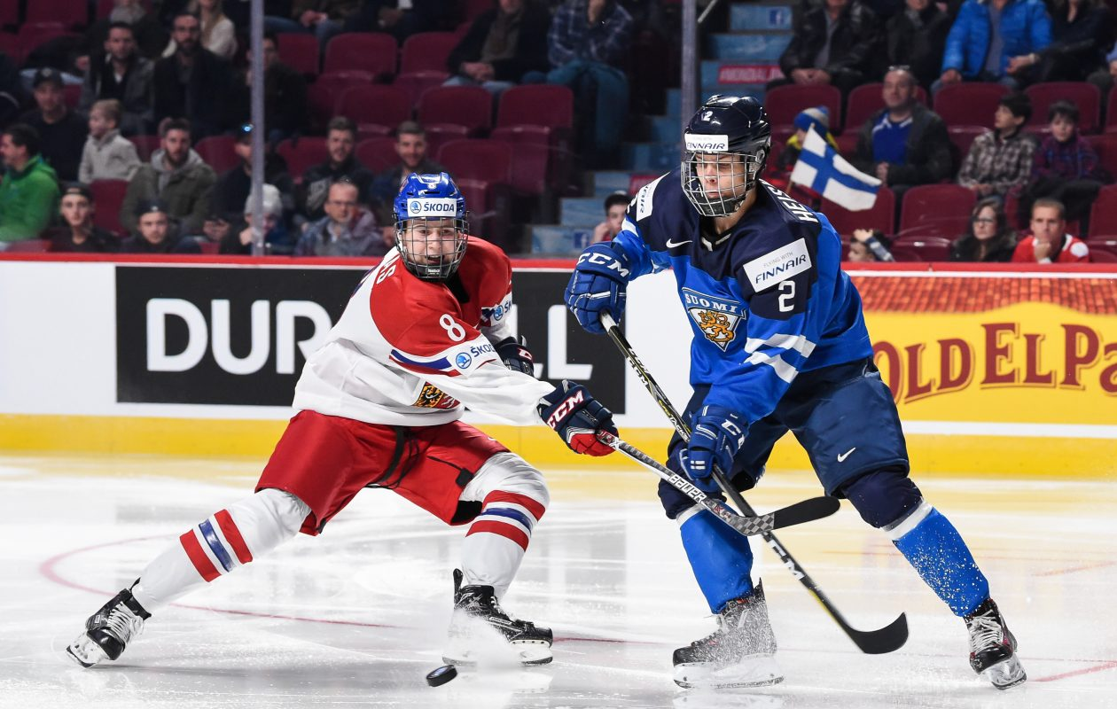 Finland's Miro Heiskanen, right, returns to the national junior team after being selected third overall by the Dallas Stars in the NHL's 2017 Entry Draft. (Getty Images)