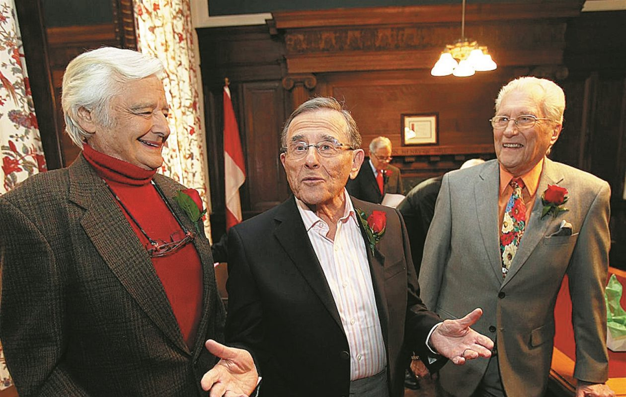 Rick Azar, Irv Weinstein and Tom Jolls, former television journalists for WKBW, chat before appearing in the 'Giants of Buffalo: Television' program at the Buffalo History Museum on Friday, March 21, 2014. (News file photo)