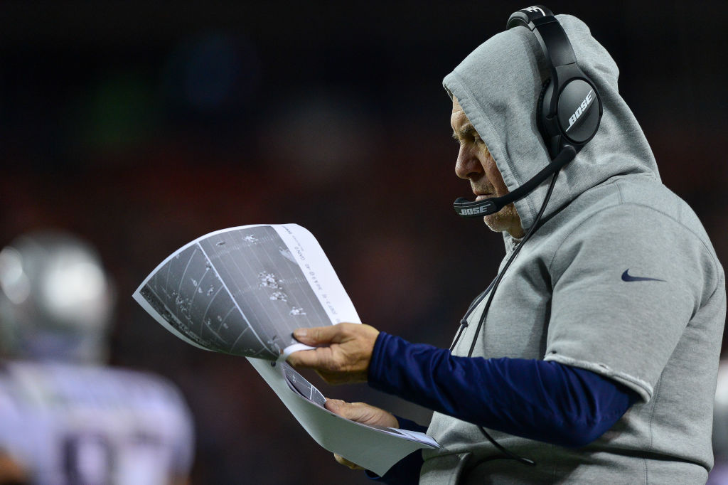 Head coach Bill Belichick of the New England Patriots reviews a printout on the sideline on November 12, 2017 in Denver, Colorado. (Photo by Dustin Bradford/Getty Images)