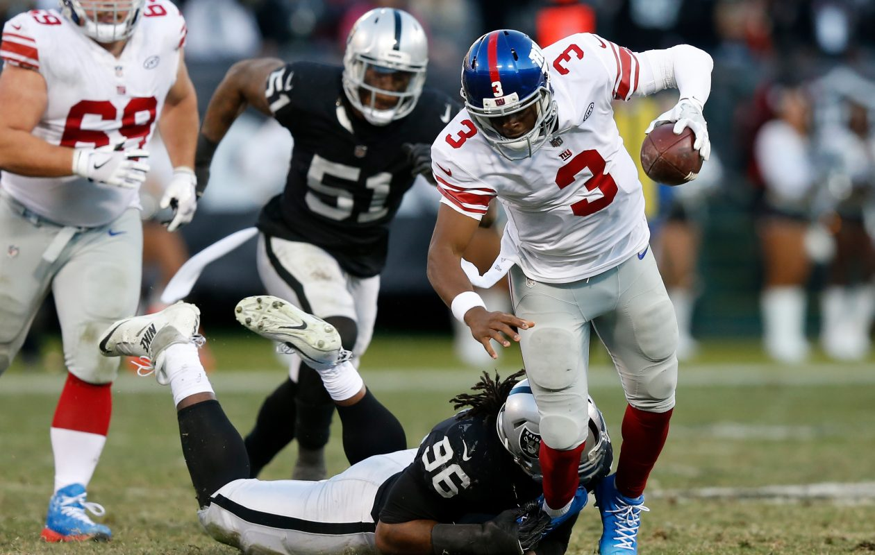 Denico Autry of the Oakland Raiders sacks Geno Smith of the New York Giants  (Lachlan Cunningham/Getty Images)