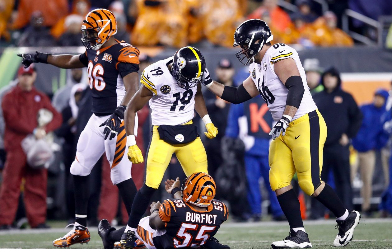 CINCINNATI, OH – DECEMBER 04:  JuJu Smith-Schuster #19 of the Pittsburgh Steelers stands over Vontaze Burfict #55 of the Cincinnati Bengals after a hit during the second half at Paul Brown Stadium on December 4, 2017 in Cincinnati, Ohio.  (Photo by Andy Lyons/Getty Images)