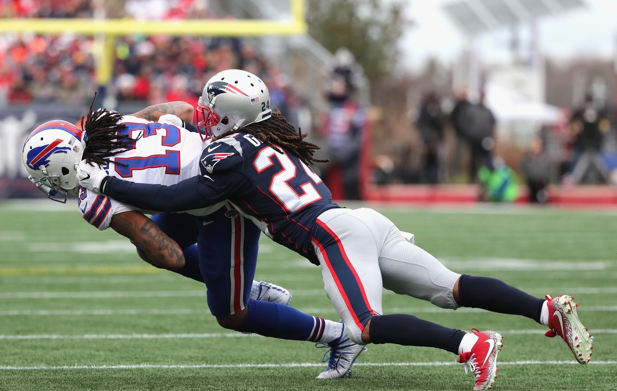 FOXBORO, MA - DECEMBER 24: Kevin Benjamin #13 of the Buffalo Bills is tackled after a catch by Stephon Gilmore #24 of the New England Patriots during the first quarter of a game at Gillette Stadium on December 24, 2017 in Foxboro, Massachusetts. (Photo by Adam Glanzman/Getty Images)