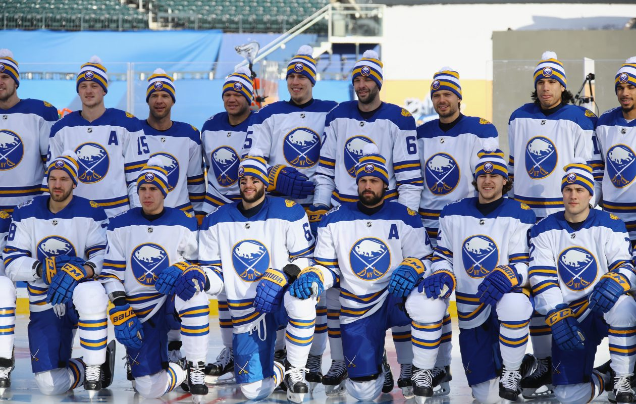 The Sabres posed for a team picture in their Winter Classic uniforms Sunday before practicing. (Getty Images)