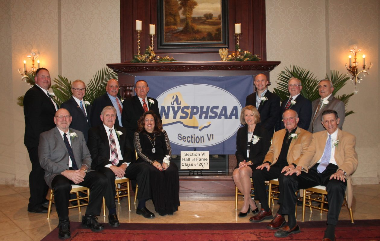 Standing left to right: Kevin Lawson on behalf of Lou Rosselli, Jim Trampert, Dick Diminuco, Patrick Monti, Dr. John Rusin on behalf of Dr. James Rusin, Phil Coyle on behalf of Matthew Szydlowski, and Bill Ross on behalf of Rich Kilgour. Seated left to right: Harris Wienke, John Hayes, Judith Coleman-Otto, Dr. Mary Lou Rusin on behalf of Dr. James Rusin, Art Serotte, and Charlie Garfinkel. (Photo provided by Timm Slade)