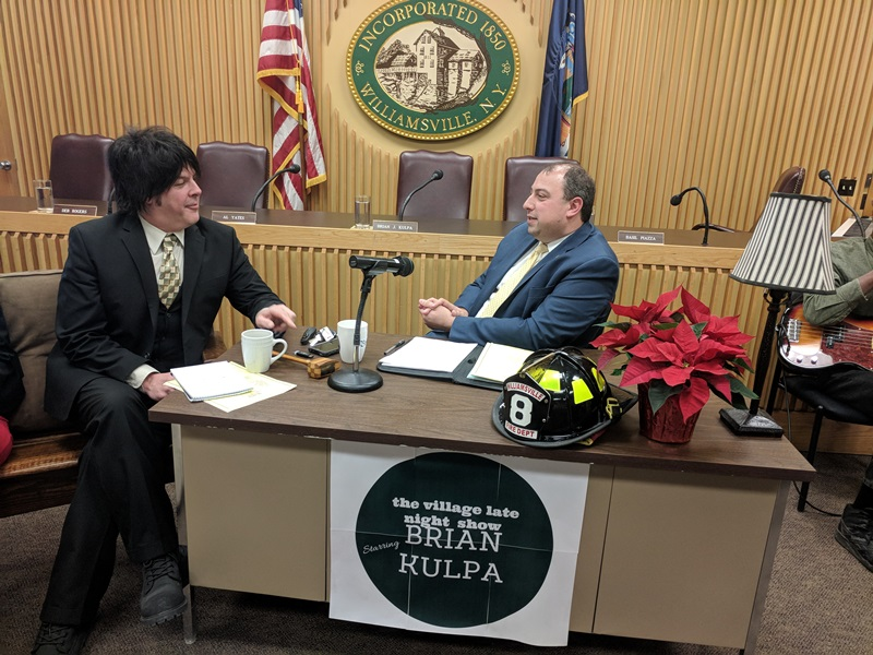 Williamsville Deputy Mayor Dan DeLano, left, chats with Mayor Brian Kulpa on Dec. 11, 2017 during Kulpa's final Village Board meeting, which was held in a talkshow format. DeLano will take over as mayor after Kulpa is sworn in as Amherst Town Supervisor. Photo provided by Village of Williamsville.