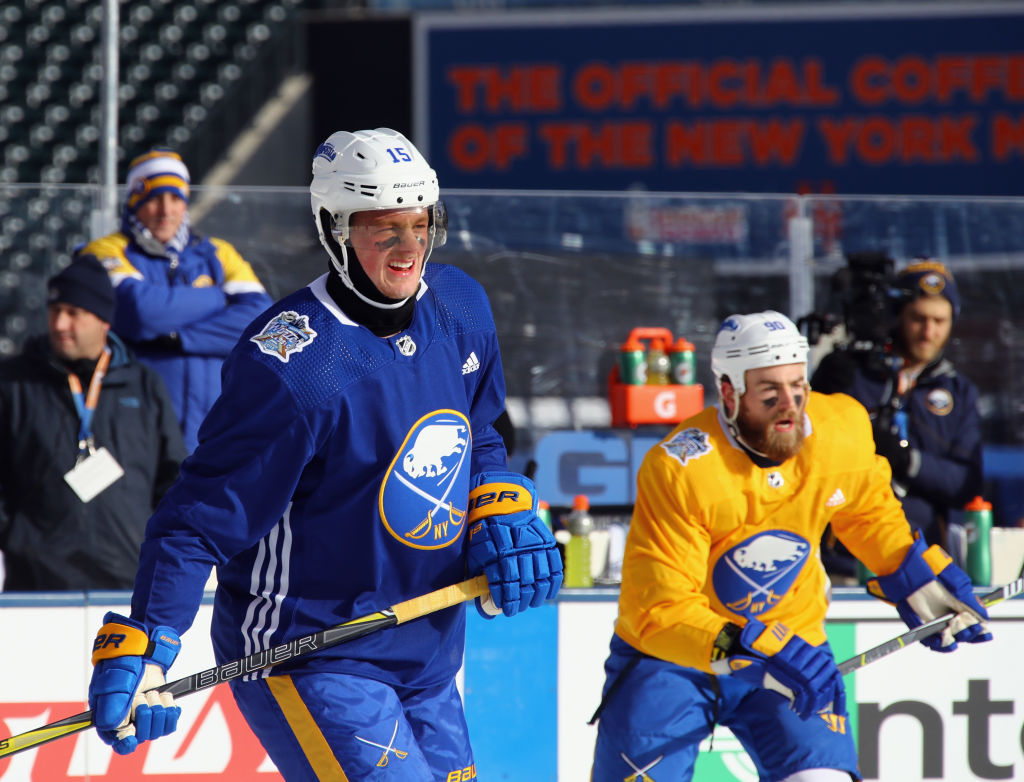 Jack Eichel, left, and Ryan O'Reilly took practice outside Sunday in frigid Citi Field. (Getty Images)