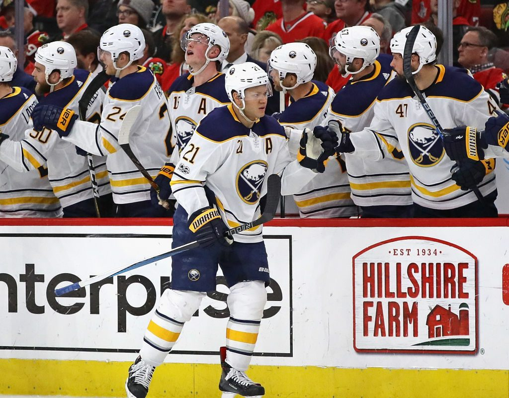 Sabres teammates give it up to Kyle Okposo after his second-period goal in Chicago. (Getty Images)
