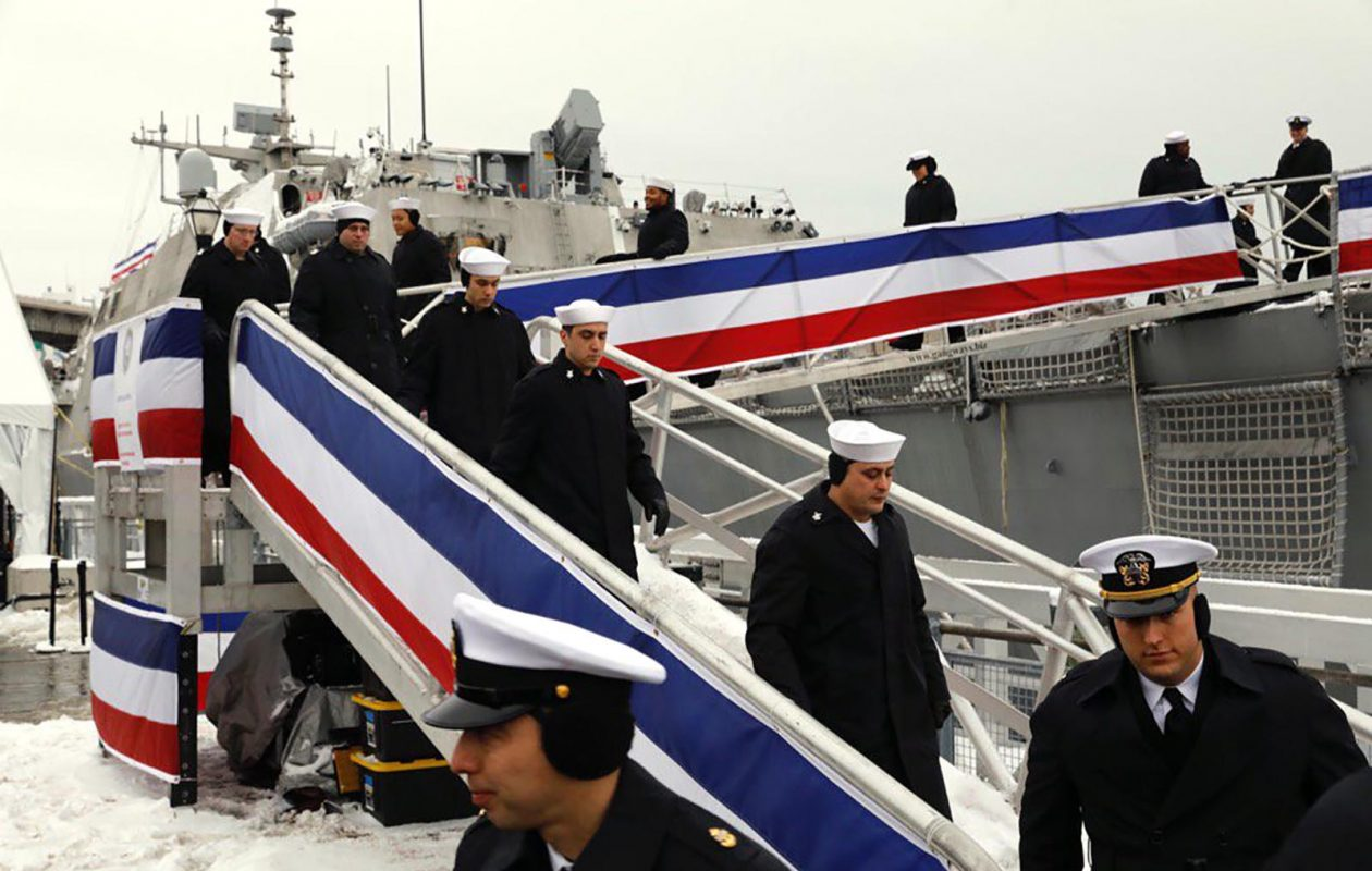 The crew of the USS Little Rock steps off the ship to take their seats for Saturday's commissioning ceremony. (Derek Gee/Buffalo News)