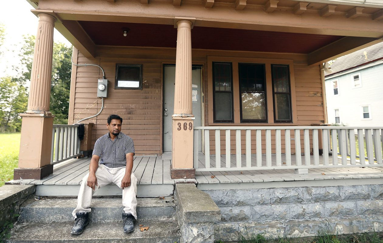 Mohammad Ismail sits on the porch of his Sherman Street home in Buffalo on Sept. 22. (Mark Mulville/Buffalo News)