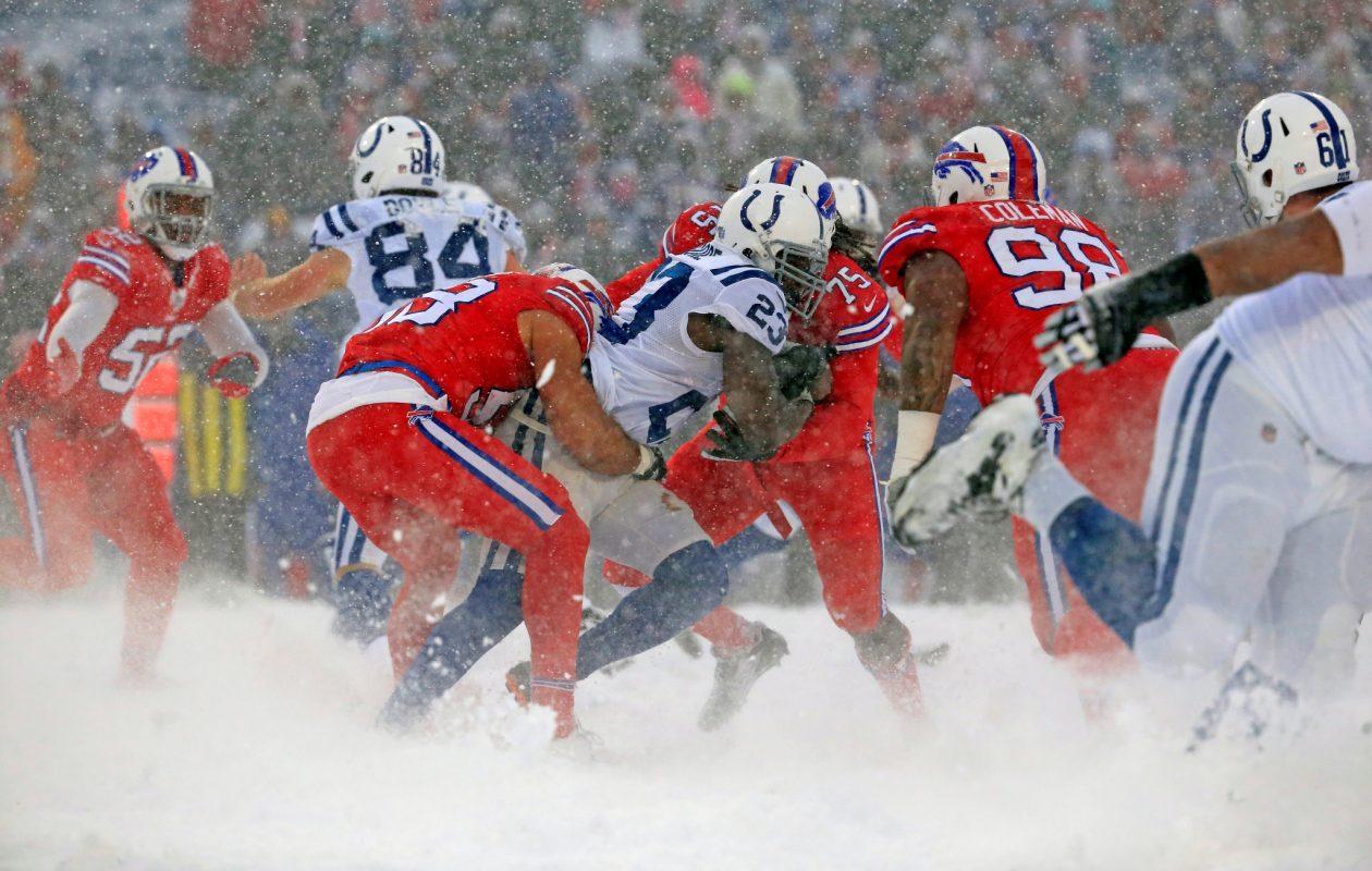 Buffalo Bills players Matt Milano and Cap Capi tackle Indianapolis Colts running back Frank Gore during third quarter action at New Era Field on Sunday, Dec. 10, 2017. (Harry Scull Jr./ Buffalo News)