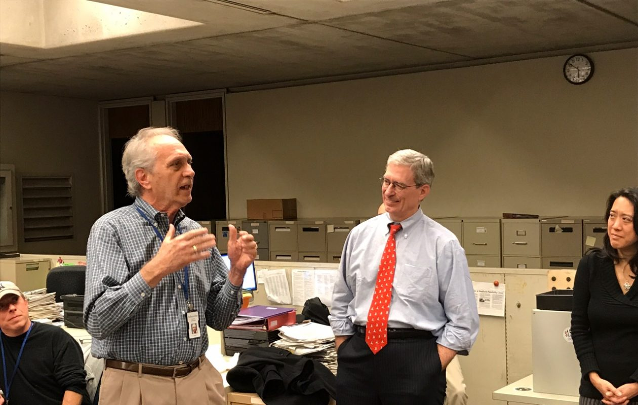 Milt Northrop addresses some of the newsroom staff during a gathering to celebrate his 50 years at the The Buffalo News. Looking on is Michael K. Connelly, the News' editor and vice president, and Sandra Tan, reporter and president of the Buffalo Newspaper Guild.