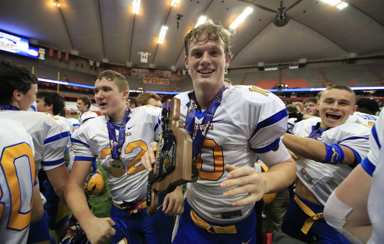 2017 Buffalo News Football Player of the Year Matt Myers with the NYSPHSAA Class A championship plaque. (Harry Scull Jr./Buffalo News)