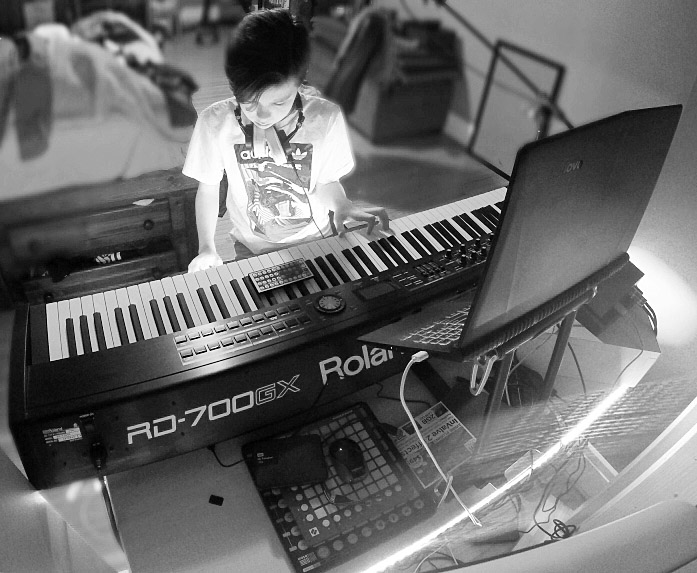 Music producer Nathan White works at his keyboard..