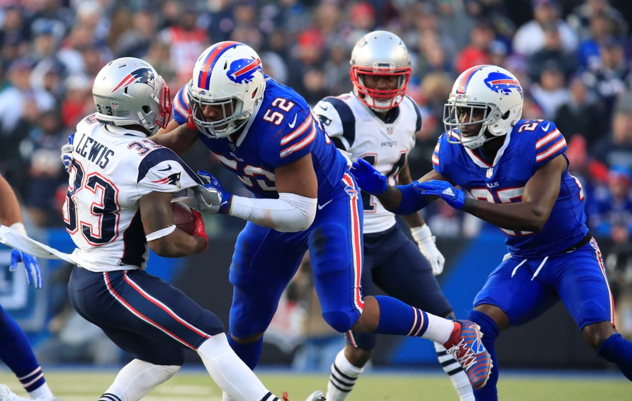 Buffalo Bills lineback Preston Brown tackles New England Patriots Dion Lewis during fourth quarter action at New Era Field on Sunday, Dec. 3, 2017. (Harry Scull Jr./ Buffalo News)