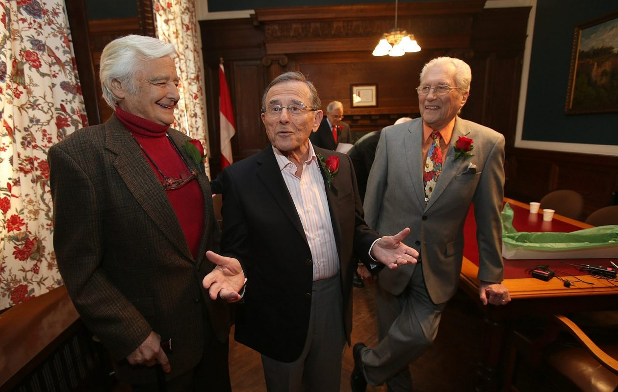 In 2014, Irv Weinstein, center, appeared alongside former colleagues Rick Azar, left, and Tom Jolls for the Giants of Buffalo: Television program at the Buffalo History Museum. Weinstein died Tuesday in California at the age of 87. (News file photo)
