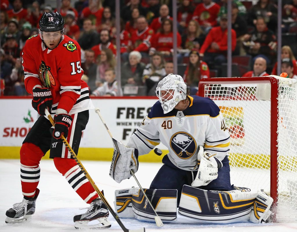 Robin Lehner battles to make a save through a screen from Chicago's Artem Anisimov (Getty Images).