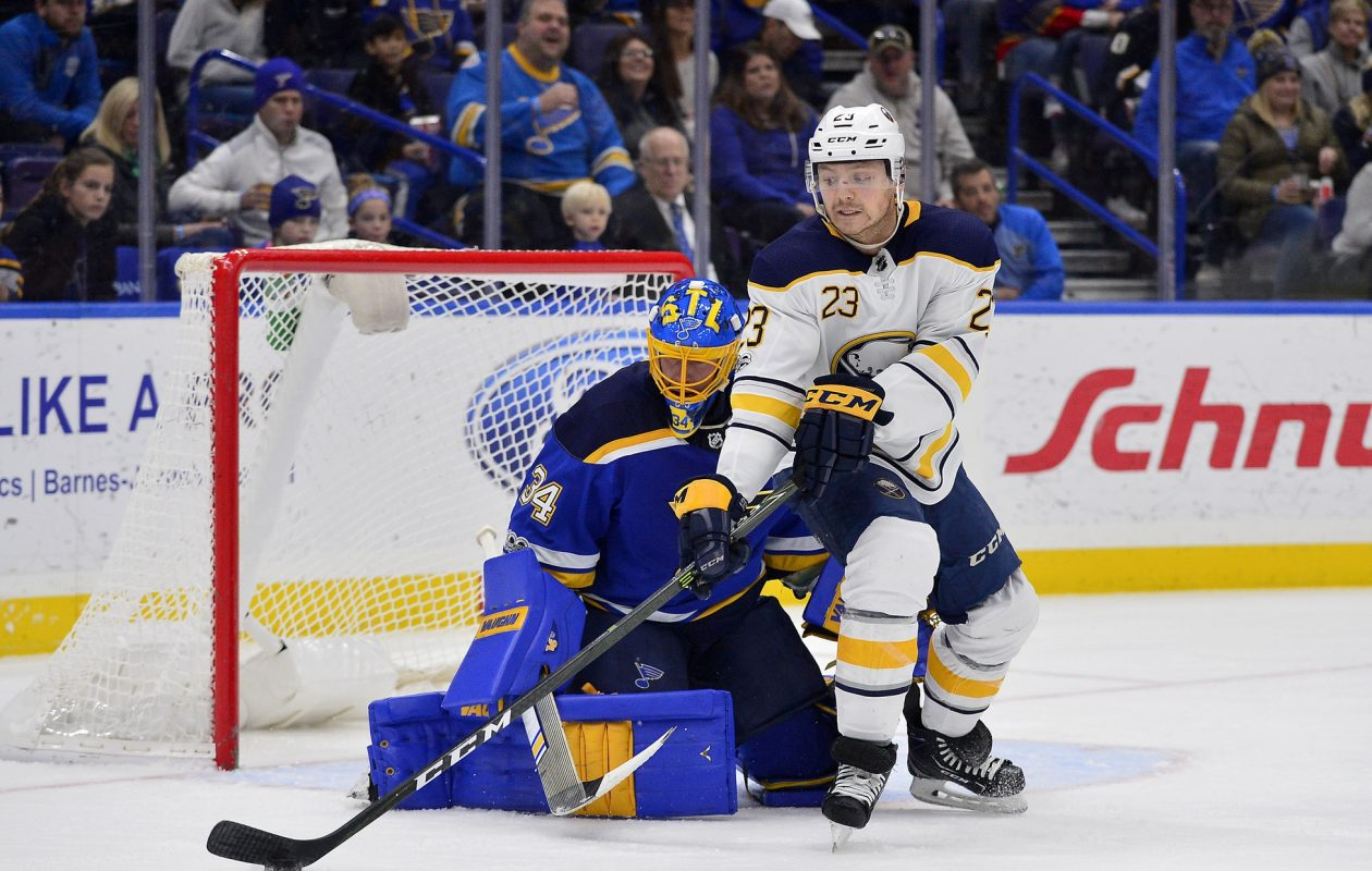 Sabres winger Sam Reinhart works against Blues goalie Jake Allen. (USA Today Sports)